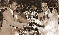 Badruddin Ahmad receiving an award from Begum Liaqat Ali the First Lady of Pakistan at the Karachi Flower Show.